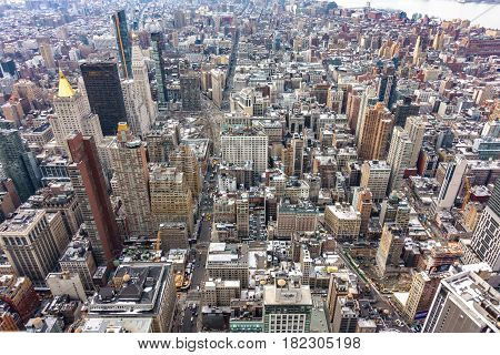 Aerial view of New York City Manhattan with skyscrapers and streets.