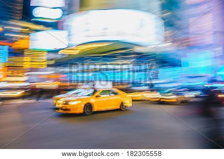 New York City - March 21 2017 : Yellow taxi cab speeds down in a New York City Street. Shot with long shutter speed for intentional motion blur.