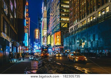 New York City USA- March 21 2017: Times Square featured with Broadway Theaters and animated colorful LED signs stores and lots of tourists and locals is a symbol of NYC and the USA in Manhattan.