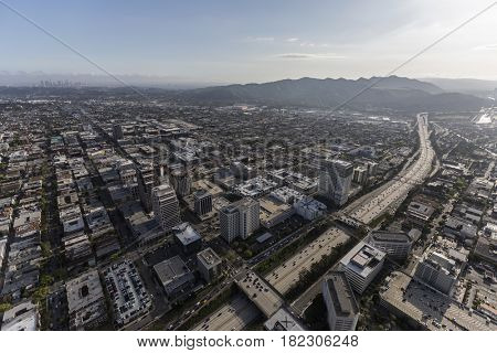 Aerial view of downtown Glendale California and the Ventura 134 freeway with Los Angeles towers in background.