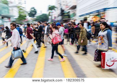 People In Motion Blur Crossing A Street In Hong Kong
