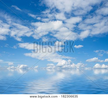 Blue sky and white clouds flaying over sea.
