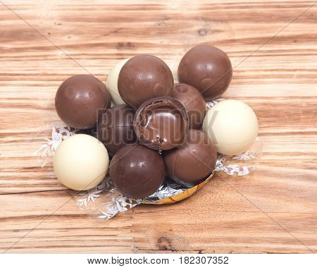 Four flavor assorted chocolate truffles on wooden vintage background