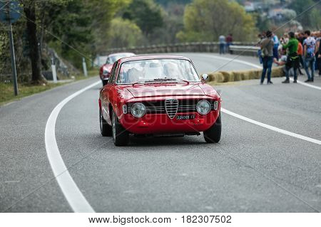 Trieste Italy - April 2 2017: Photo of a Alfa Romeo Giulia Sprint GT Veloce on the Trieste Opicina Historic. Trieste Opicina Historic is regularity run for vintage and classic Cars.