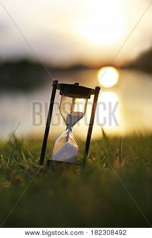 Vintage hourglass in the dawn time (Vertical)