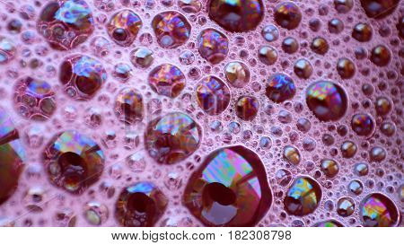 Soap bubbles as background / A soap bubble is an extremely thin film of soapy water enclosing air that forms a hollow sphere with an iridescent surface