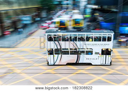 Hong Kong Hong Kong - March 09 2017: HK tramway in motion blur with unidentified people. The Trams in HK have not only been a commuter transport for over 110 years also a major tourist attraction