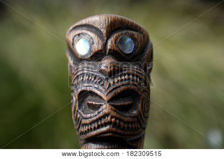 New Zealand Maori Carving of Face with Paua Eyes