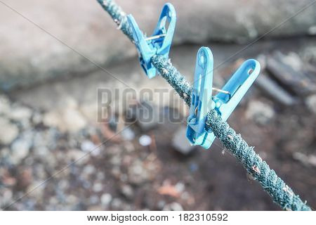 close up blue clothes peg with selective focus