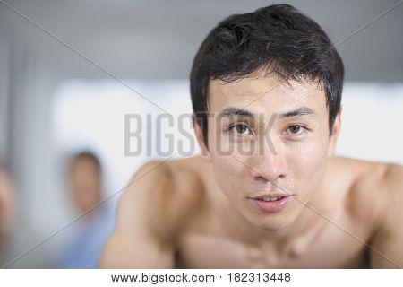 Asian man sweating