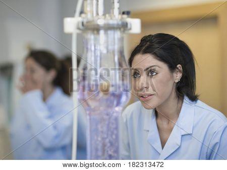 Hispanic scientist working in laboratory