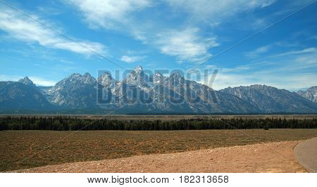 Grand Teton Peaks under summer cloudscape seen from Glacier View Turnout in Grand Teton National Park in Wyoming USA