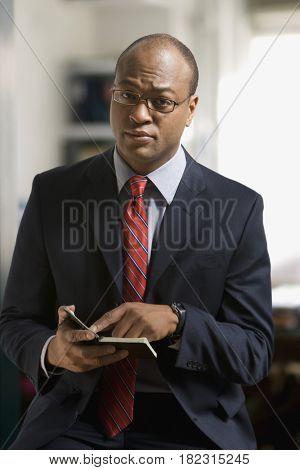 African businessman checking schedule