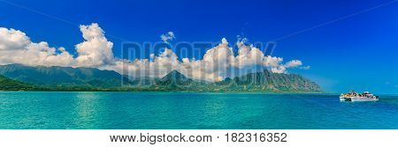 Panoramia Of Tropical Lagoon, Lush Mountains, A Catamaran And The Ocean In Oahu, Hawaii