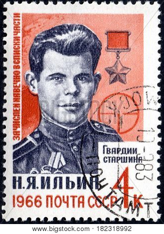 UKRAINE - CIRCA 2017: A postage stamp printed in USSR shows Portrait of Hero of USSR N. Ja. Il'in 1922-1943 from the series Heroes of Second World War circa 1966