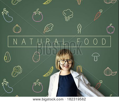 Little girl with a vegetables icon on the board