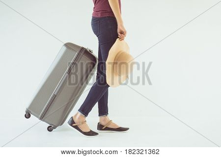 Vintage tone of Exciting woman drag a luggage