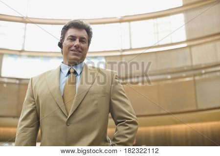 Confident Hispanic businessman with earpiece