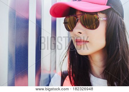 Young Girl In Glasses And A Baseball Cap