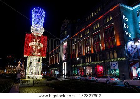 BERLIN - DECEMBER 07 2016: The shopping street of West Berlin Tauentzienstrasse in the Christmas illuminations. In the background the KaDeWe department store building.