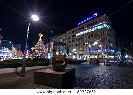 BERLIN - DECEMBER 07 2016: The shopping street of West Berlin Tauentzienstrasse in the Christmas illuminations. In the foreground is sculpture