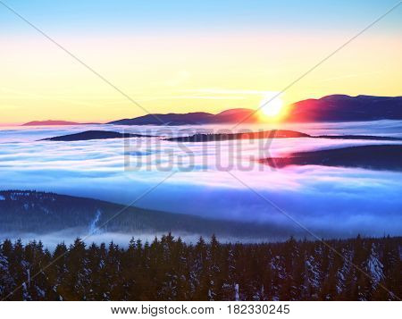 Inverse Weather In Mountains, Shinning Fog. Misty Valley In Winter