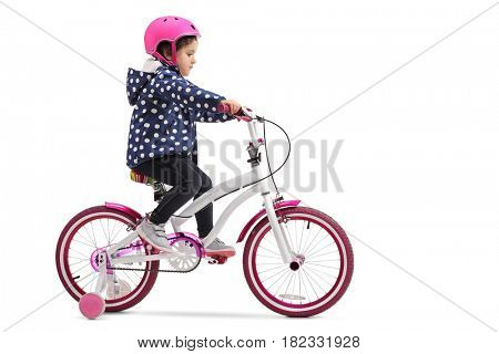 Cute little girl riding a bike isolated on white background
