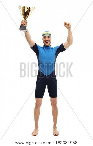 Full length portrait of an overjoyed swimmer holding a gold trophy and gesturing happiness isolated on white background