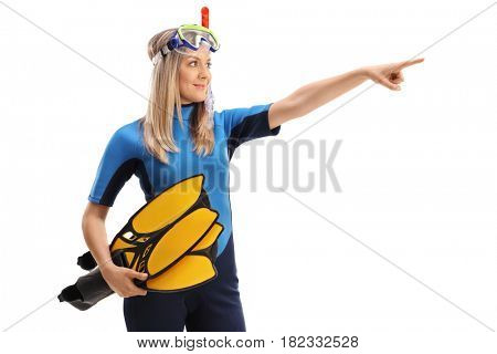 Woman in a wetsuit with snorkeling equipment pointing in the distance isolated on white background
