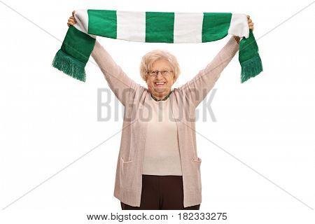 Overjoyed elderly football fan holding a scarf isolated on white background