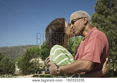 African couple kissing