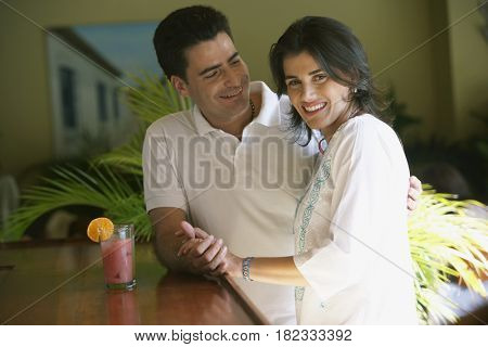 Couple drinking in bar
