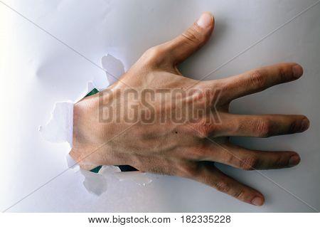 Man Climbs Through Hole In Paper.