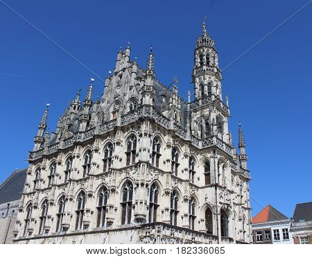 The beautiful 14th century, late gothic style Oudenaarde Town Hall, in East Flanders in Belgium. Against a background of blue sky with copy space.