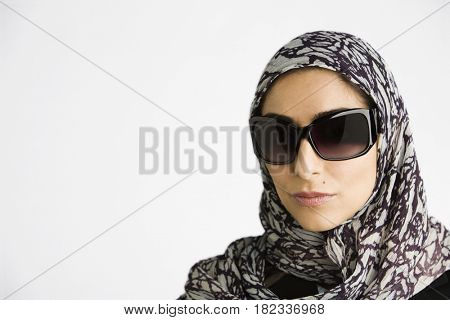 Middle Eastern woman in burkha and sunglasses