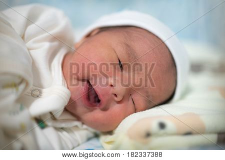Asian New born Baby sleep in the bedroom