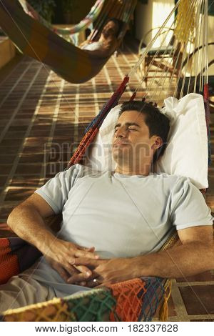 Man laying in hammock