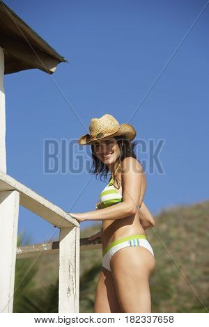 Woman standing in lifeguard tower