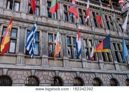 Antwerp Belgium - July 28 2016: Flags in The Town Hall of Antwerp. It is located in the heart of the old city quarter.