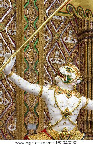 Statue hanuman raised flag. temple in thailand