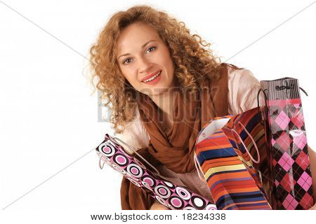 Portrait of an attractive young woman with shoppingbags isolated on white background