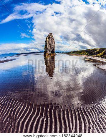 Northern coast of Iceland. Magic Rock Hvitsercur at sunset. The picture was taken Fisheye lens. Concept of extreme northern tourism