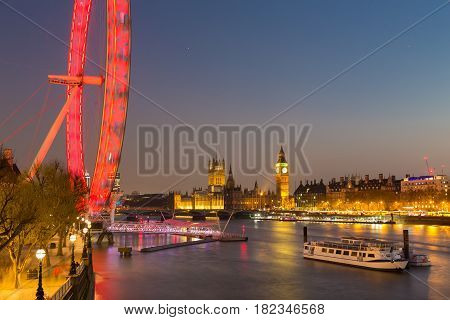London, UK - April 7, 2017: London cityscape with world famous landmarks of London Eye, Big Ben and Palace of Westminster aka Houses of parliament on 7th of April, 2017 in London, UK.