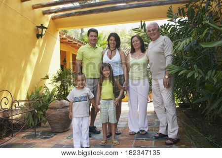Multi-generational family standing outdoors