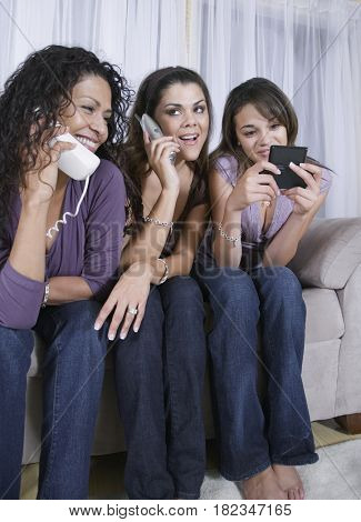 Multi-generational women using different phones