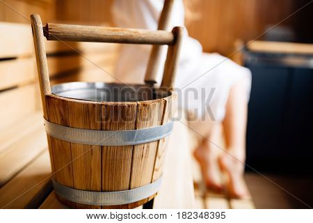 Retro finnish wooden sauna bucket in sauna