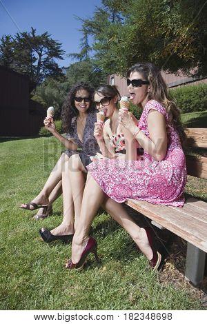 Multi-generational women enjoying ice cream cones