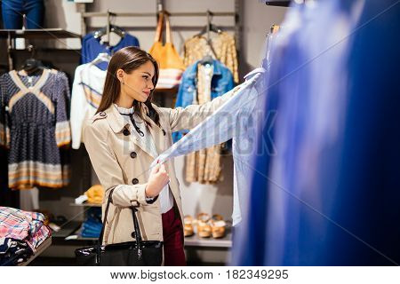 Beautiful pretty young woman shopping trendy clothes