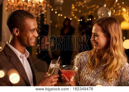 Couple Chat As They Enjoy Cocktail Party Together