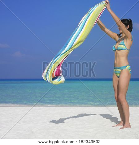 Woman laying out beach towel